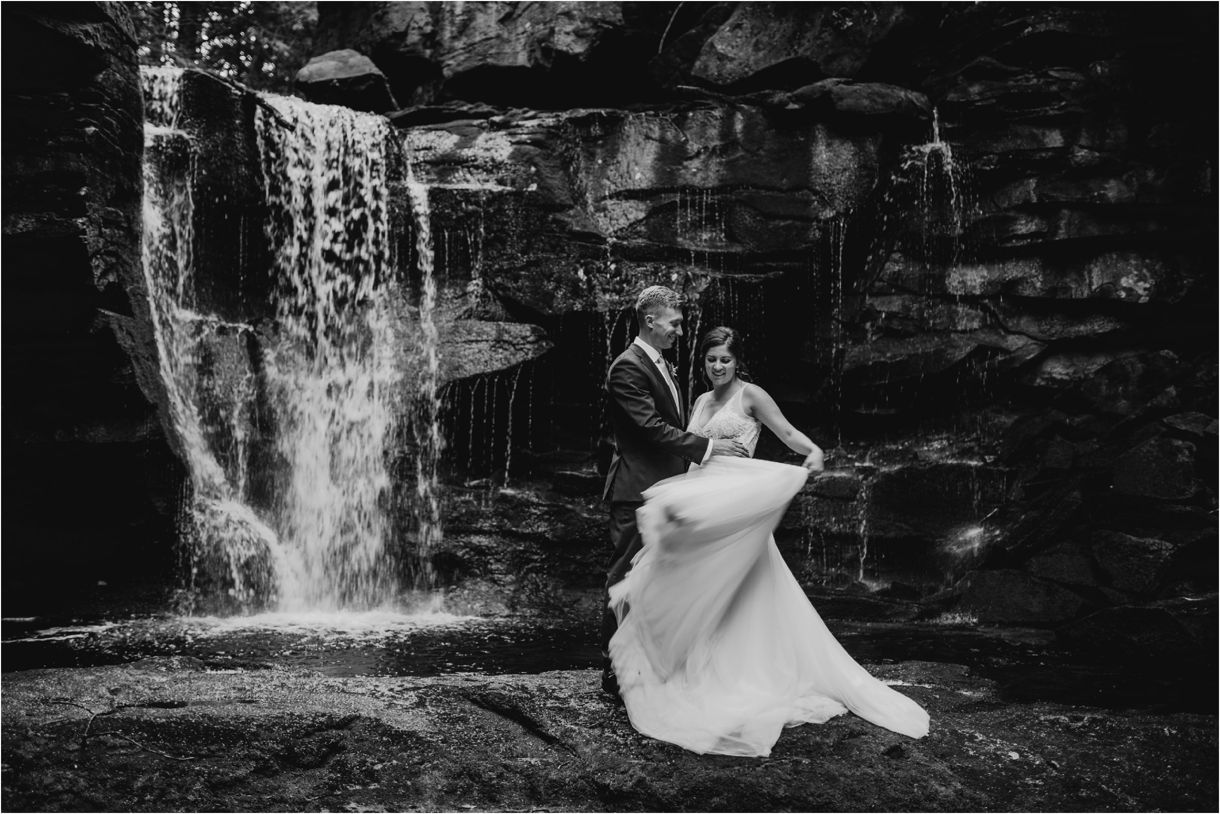 bride and groom at waterfalls on wedding day