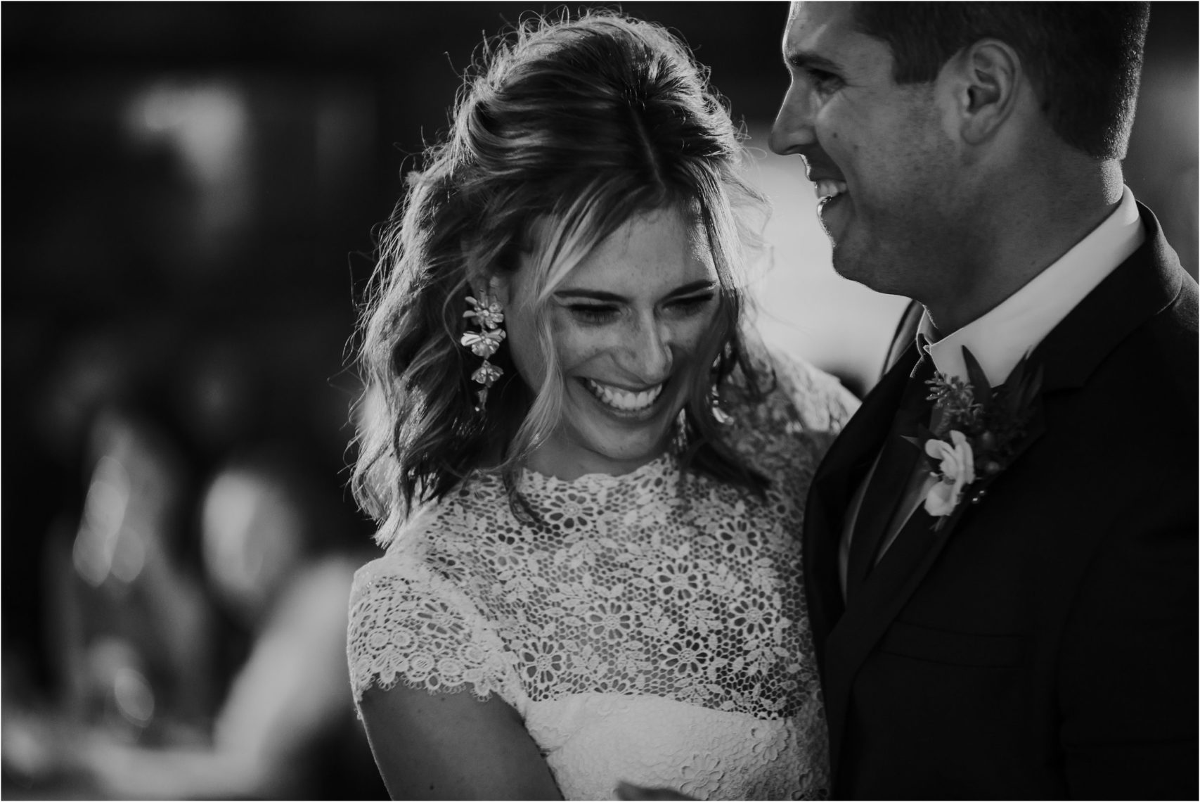black and white image of bride and groom dancing at Maryland wedding
