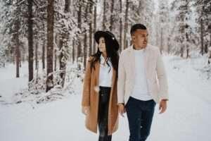 couple walking in snow in colorado