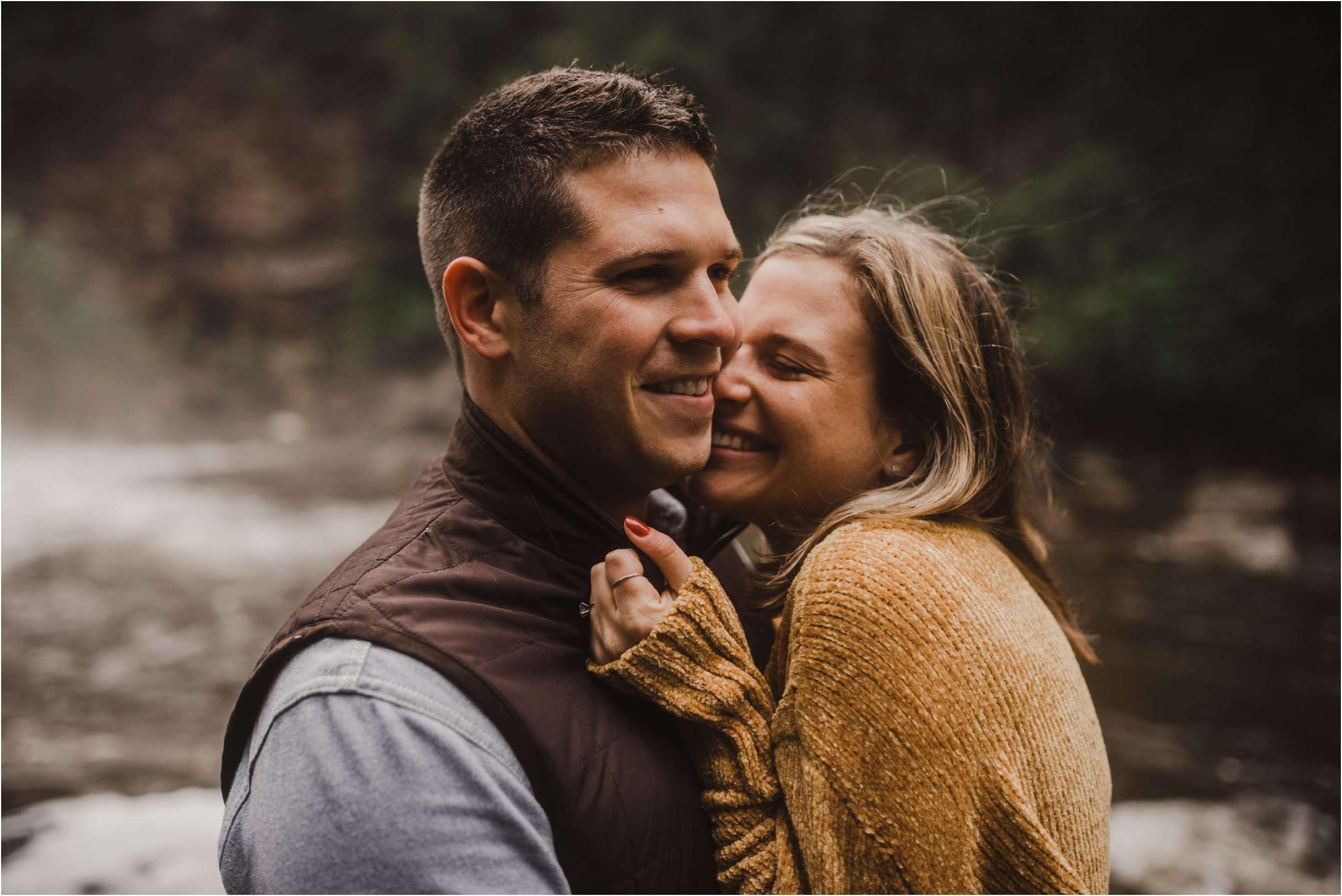 engaged couple cuddling at engagement session at Swallow Falls Maryland