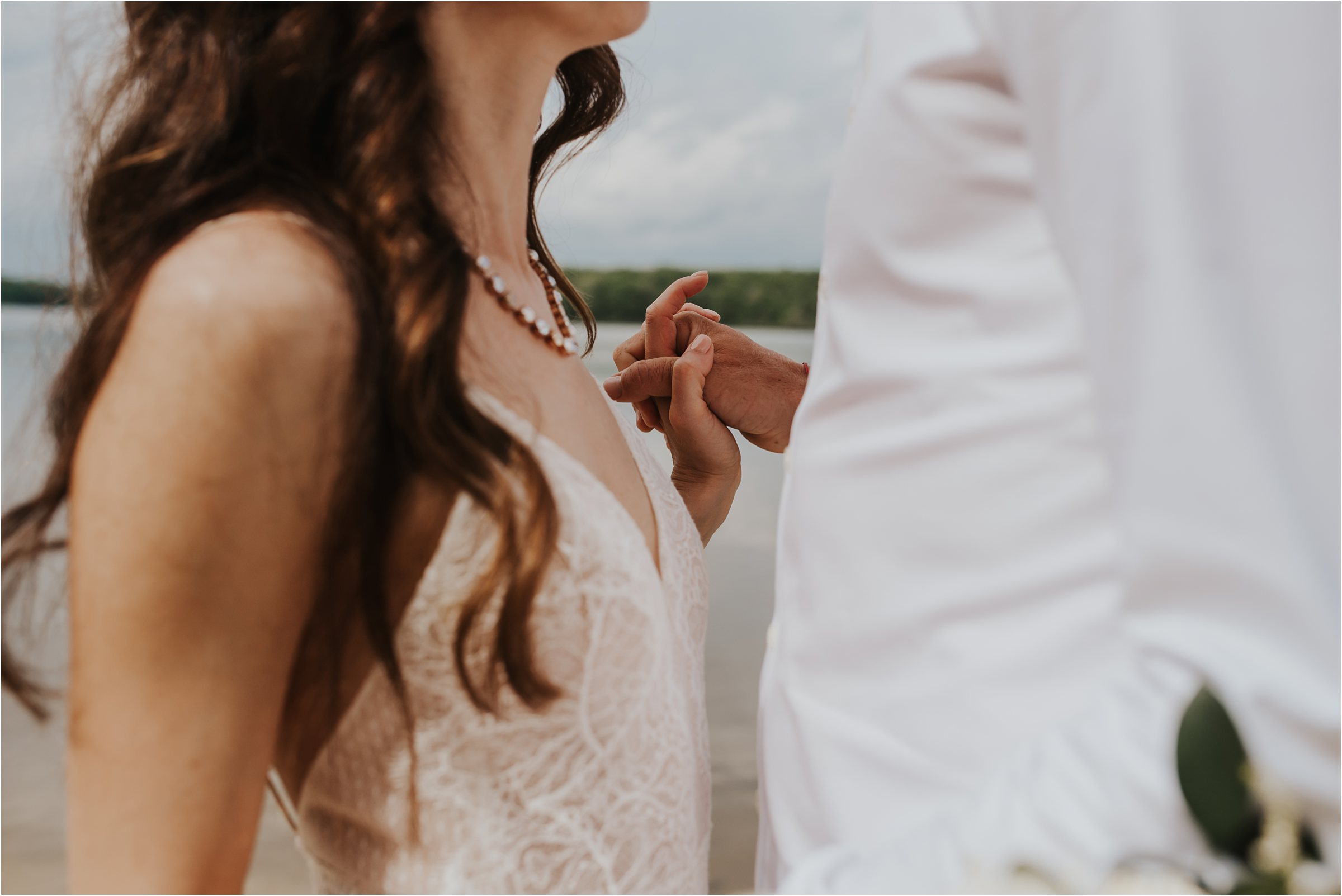 bride and groom holding hand at elopement