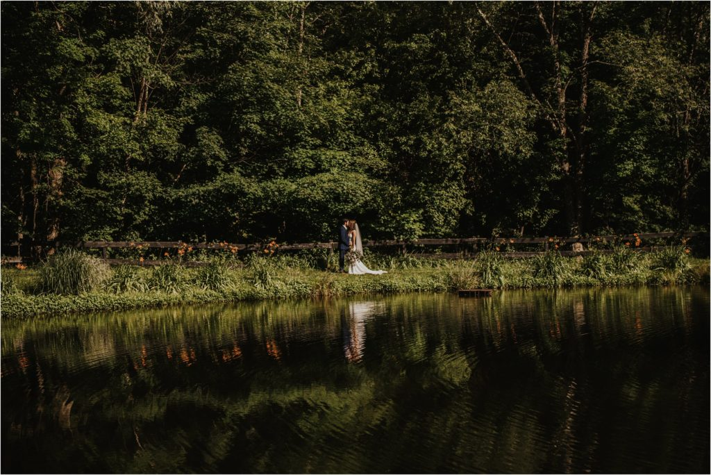 bride and groom at lake at Maryland wedding