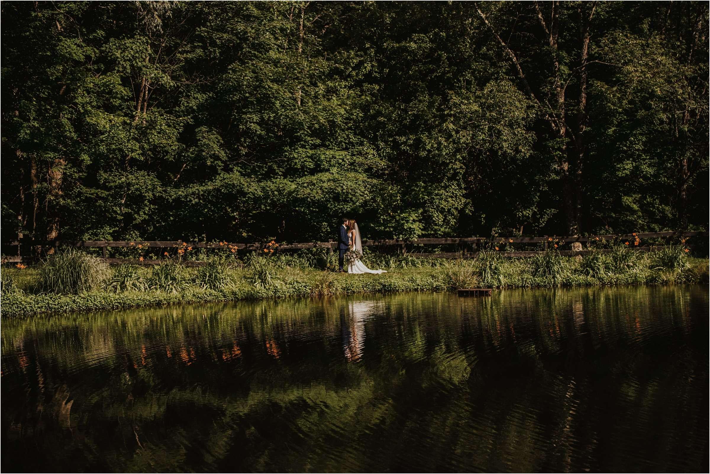 bride and groom at lake at Maryland wedding