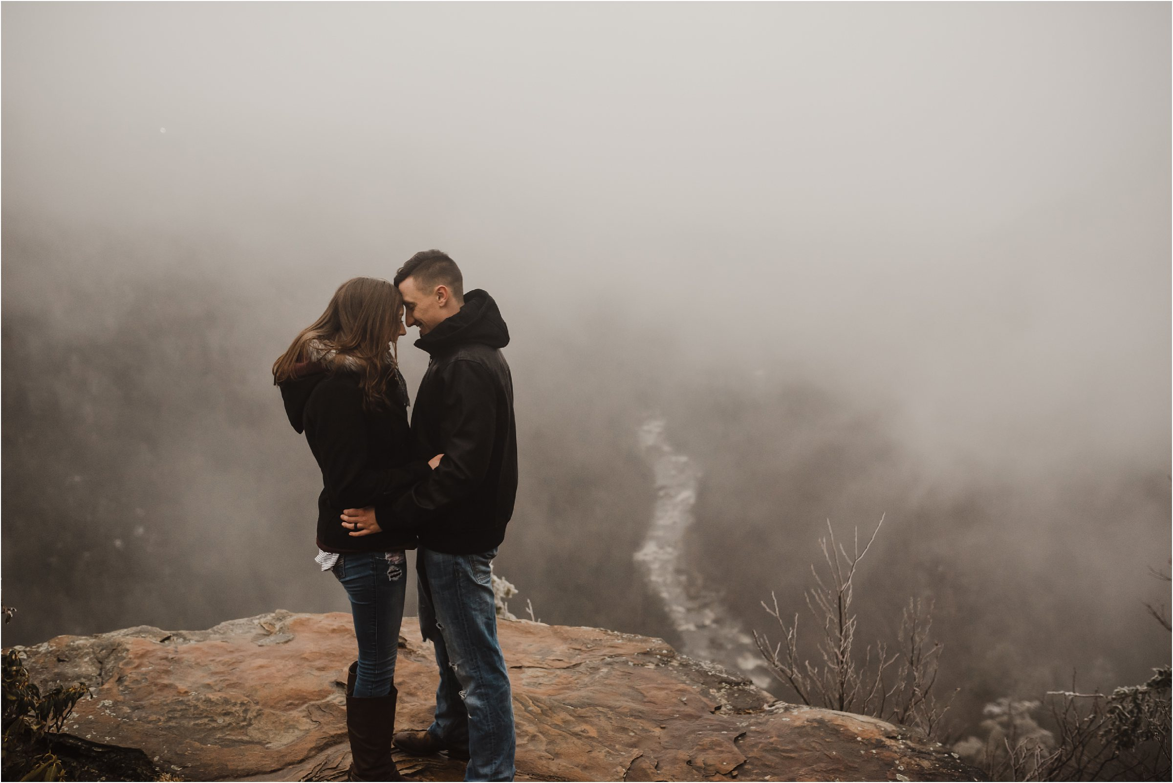 couple at blackwater falls on mountain top
