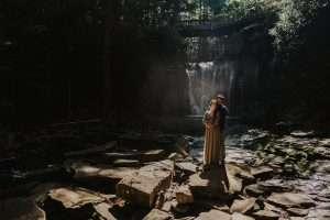 couple hugging by ekalala waterfalls